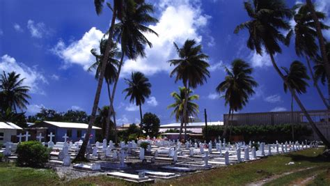 Rising seas are washing away graves in the Marshall Islands