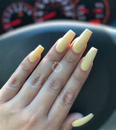 Pastel yellow matted coffin or ballerina nails in medium