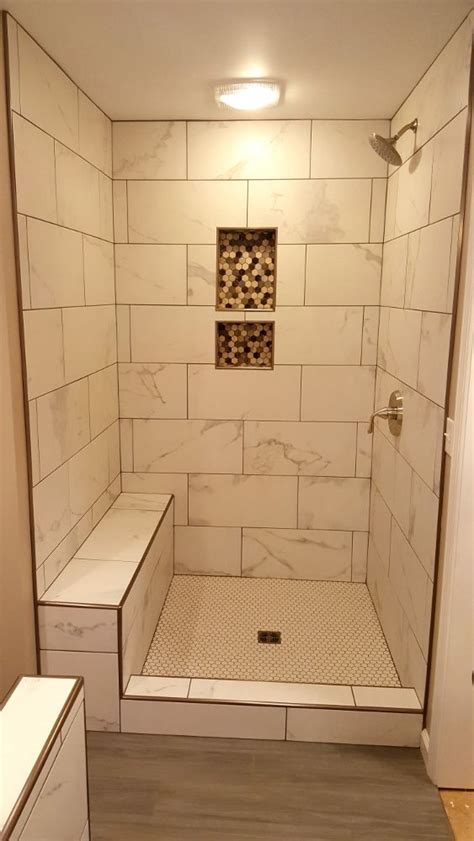 Grouted 12 x 24 tile with marble look, Schluter edging on