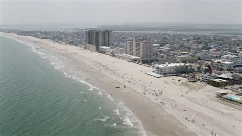 5K stock footage aerial video of beach goers and