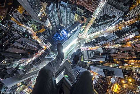 The only way is down: Fearless daredevil poses for stomach