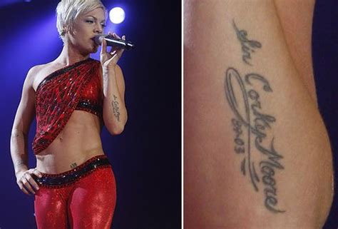 """The tattoo on Pink's left forearm arm reads """"Sir Corky"""