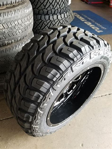 """20x12 Xd 825 Wheels and 33"""" Mud Tires for Sale in Orange"""